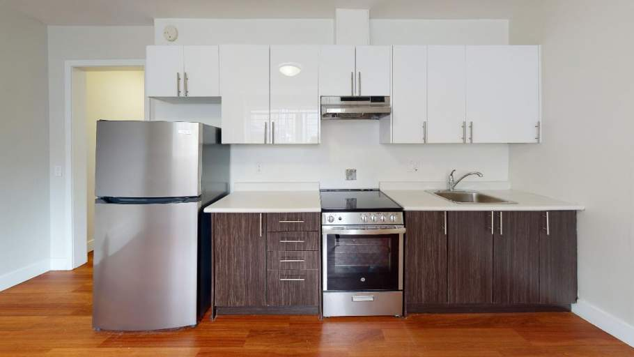 Renovated kitchen with stainless steel appliances and dark brown cabinets