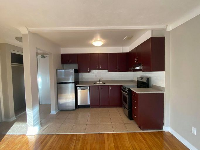 Renovated kitchen with stainless steel appliances, and dark brown cabinets