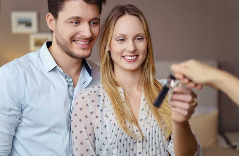 The Carlton Apartments couple with keys