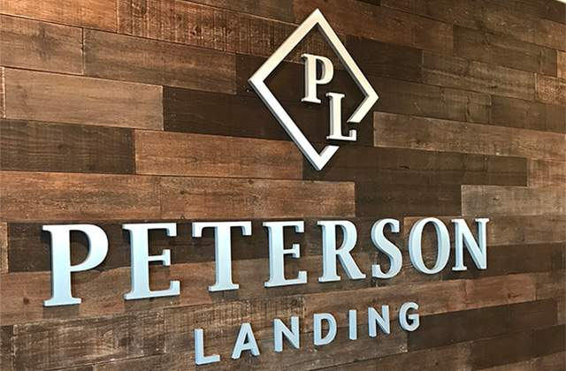 Peterson Landing Apartments lobby metal logo
